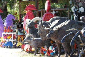 A row of colorful animal statues at Barberville Roadside.